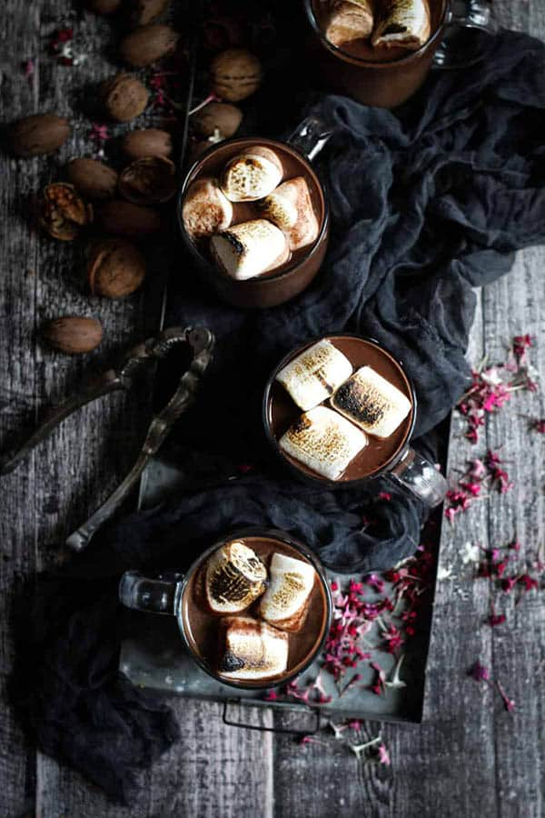 3 glasses of Red Wine Hot Chocolate topped with toasted marshmallows.