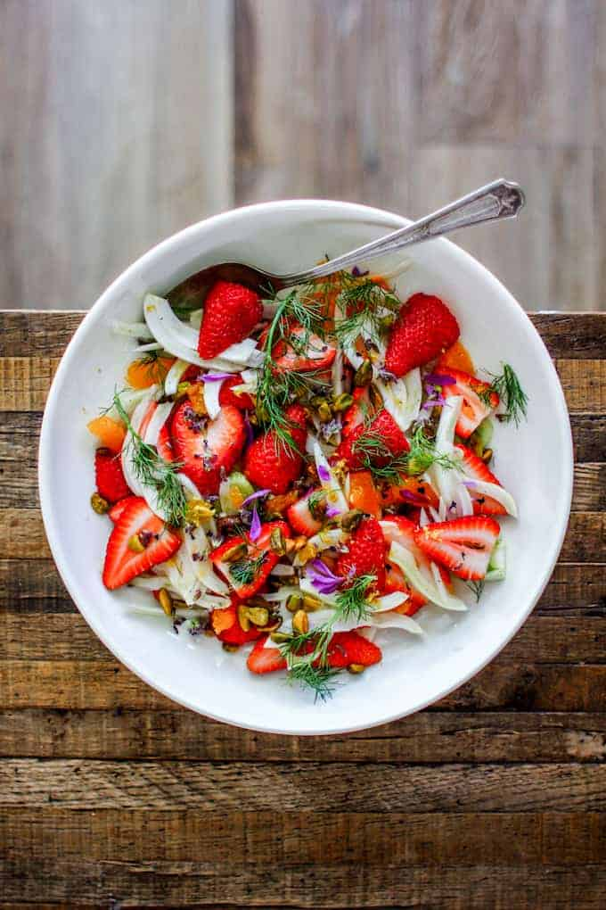 This is how to use honey, make a dressing for fruit salad. A winter fruit salad with strawberries, fennel, clementines, and honey.