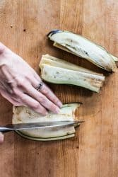 Slicing thin strips of eggplant in half