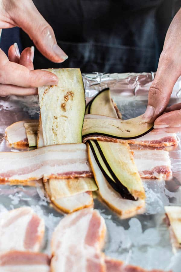 Thinly sliced eggplant being layered into the bacon weaves for BLT sandwiches.