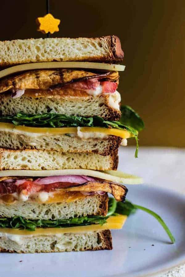 A multi level vegetarian club sandwich.