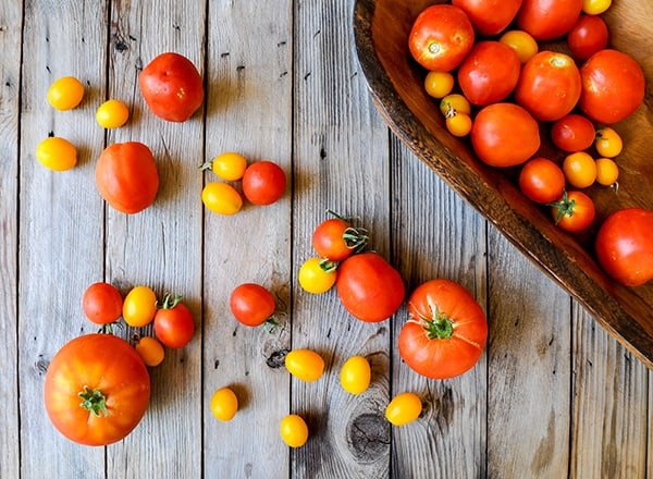 A variety of colorful heirloom tomatoes on a table.