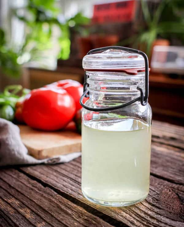 Clear tomato water in a small jar.