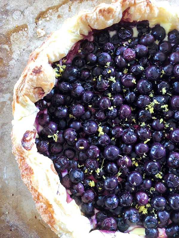 A galette made with blueberries and lemon zest.