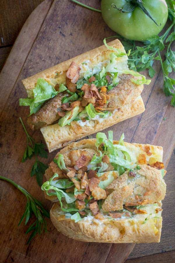 Fried green tomatoes, lettuce, and coconut bacon crumbles stuffed in a  toasted baguette and drizzled with remoulade sauce.