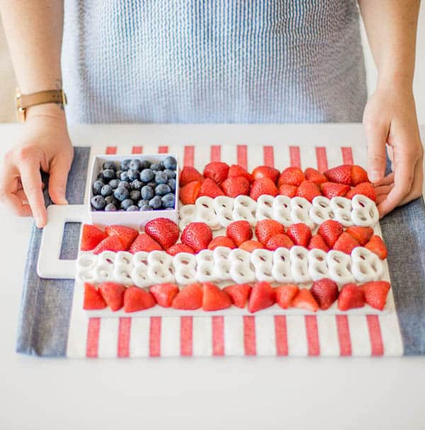 A red, white and blue dessert that is healthy! A fruit tray made with white yogurt covered pretzels, red strawberries, and blueberries.