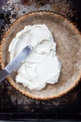 Tart recipe being covered in goat cheese.