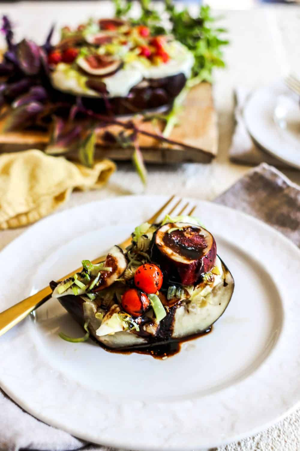 Slices of Baked Eggplant with California Figs and Leeks drizzled with balsamic reduction.