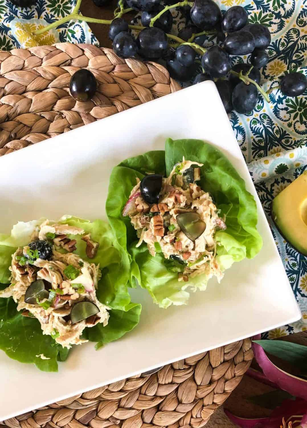 Lettuce cups filled with a chicken, radish , and grape salad.