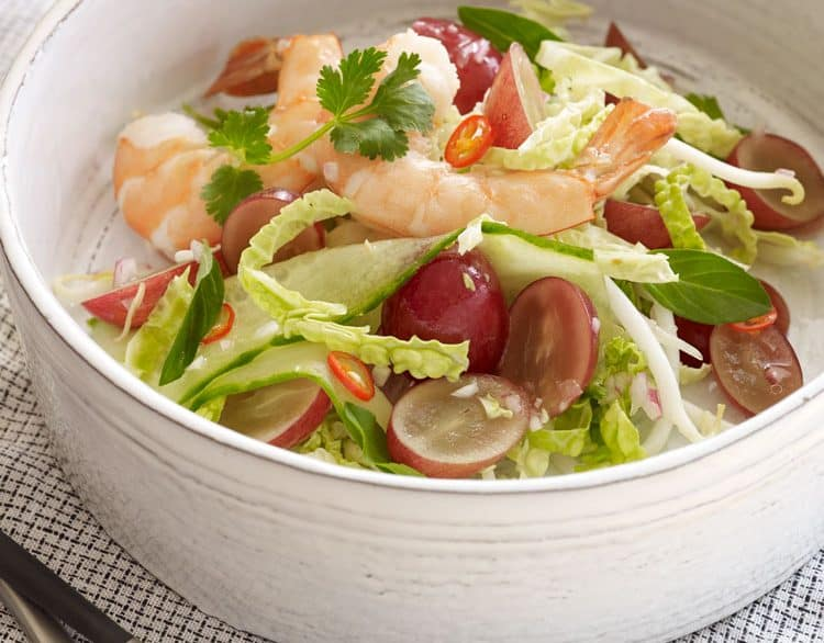 Shrimp Thai Salad with Grapes, cabbage, peppers, cucumbers, and shrimp.