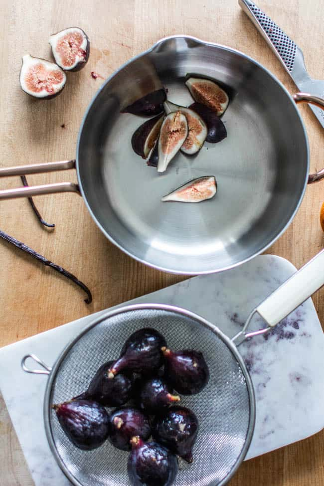 Figs and vanilla beans being prepared to go into a skillet to make fresh fig compote for an easy creme brûlée recipe.