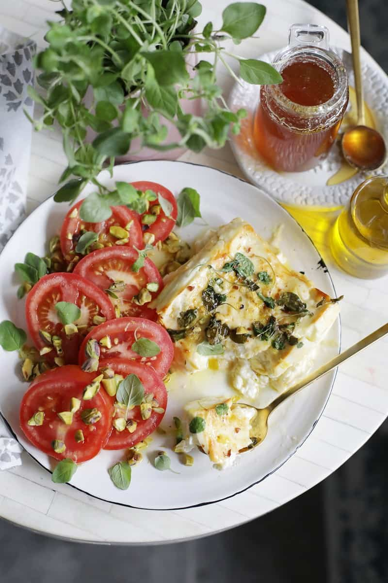 Honey and Oregano Broiled Feta Caprese from Salt and Wind is a delicious recipe for Happy Hour at Home