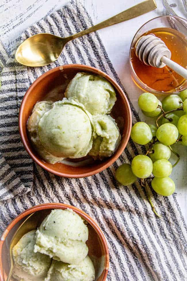 Two bowls of green grape nice cream