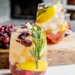 A glass of Rosemary and Roasted Grape Wine Cocktail